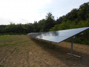off grid solar panels in a field